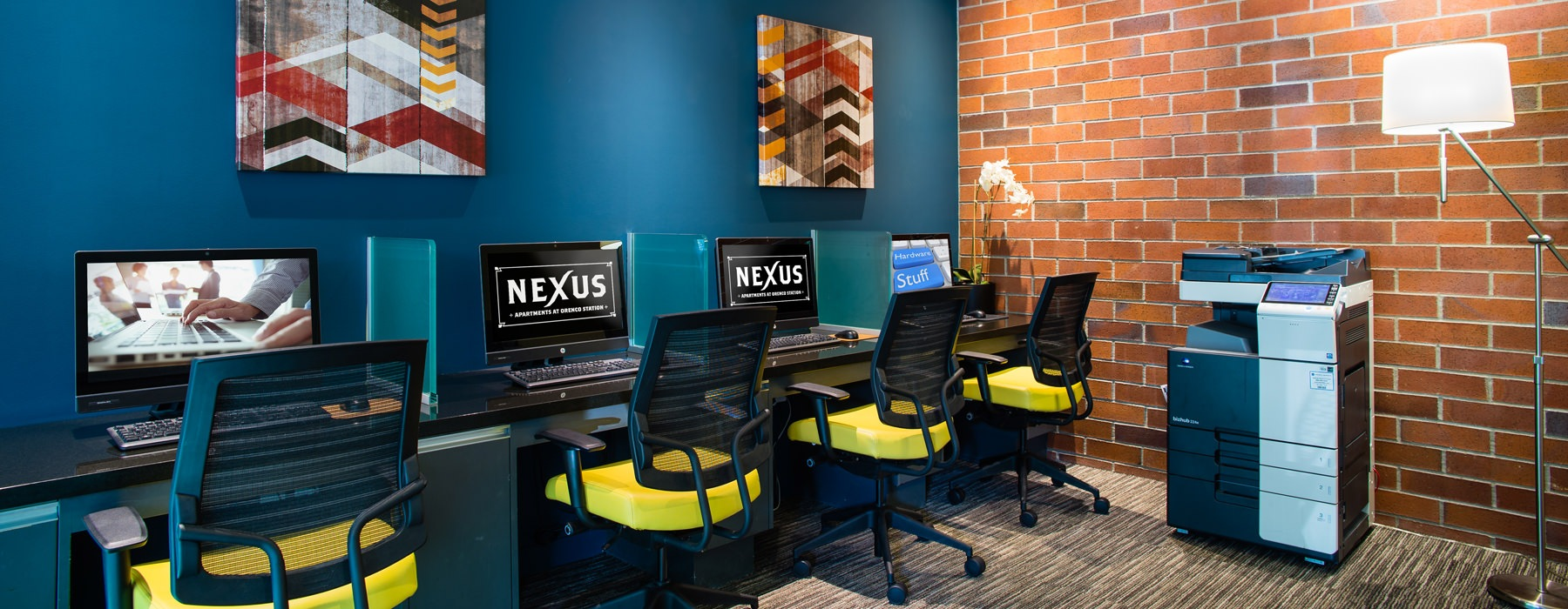 Business Center with computer stations against a wall and large printer